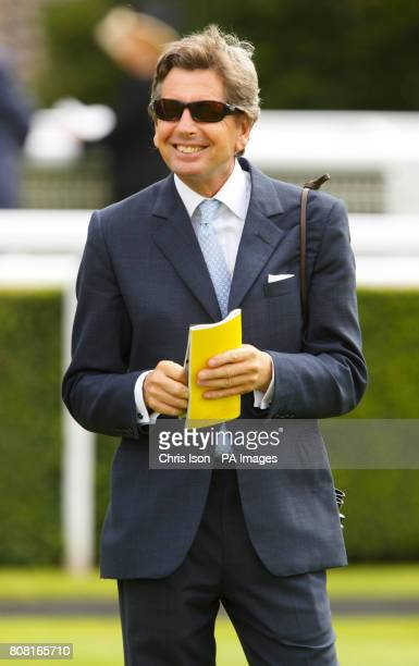 John Warren racing adviser to Her Majesty The Queen during day three of Glorious Goodwood at Goodwood Racecourse Chichester