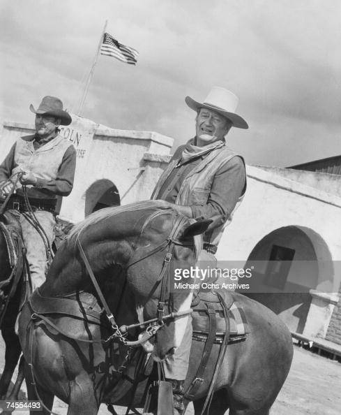John Wayne and Ben Johnson on the set of 'Chisum' directed by Andrew V McLaglen in 1970 in Durango Mexico