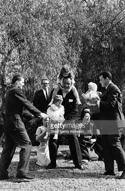 John Wayne at home with his children and grandchildren in 1960 in Encino California