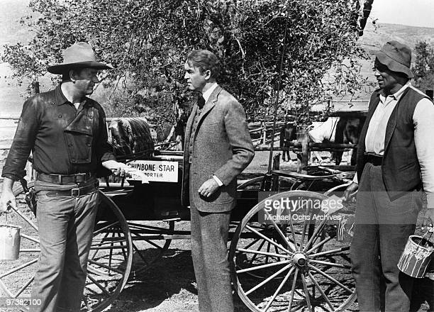 John Wayne James Stewart and Woody Strode on the set of the movie 'The Man Who Shot Liberty Valance' in 1962 at Janss Conejo Ranch in Thousand Oaks...
