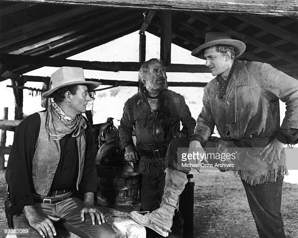 John Wayne Ward Bond and James Arness on the set of the movie 'Hondo' in 1953