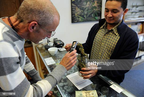POT30 John Weathersby who has amyotrophic lateral sclerosis often referred to as 'Lou Gehrig's Disease' left buys medical marijuana at Cannabis...