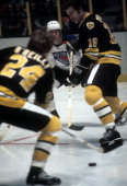 John Wensink and Terry O'Reilly of the Boston Bruins go for the puck as Don Awrey of the New York Rangers defends on March 18 1978 at the Madison...