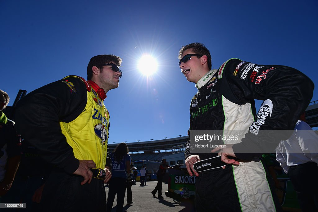 John Wes Townley, driver of the #7 Zaxby's Toyota, talks with Dakoda Armstrong, driver of the #60 WinField Chevrolet, during qualifying for the NASCAR Camping World Truck Series WinStar World Casino 350k at Texas Motor Speedway on November 1, 2013 in Fort Worth, Texas.