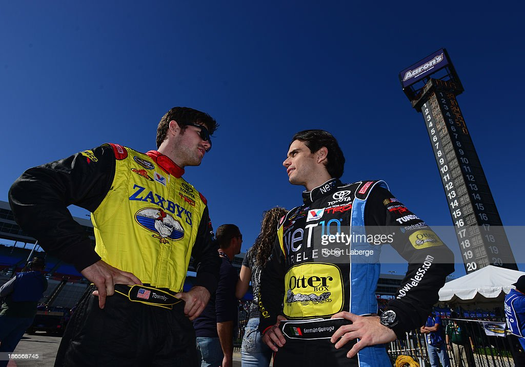 John Wes Townley, driver of the #7 Zaxby's Toyota, talks with John Wes Townley, driver of the #7 Zaxby's Toyota, during qualifying for the NASCAR Camping World Truck Series WinStar World Casino 350k at Texas Motor Speedway on November 1, 2013 in Fort Worth, Texas.