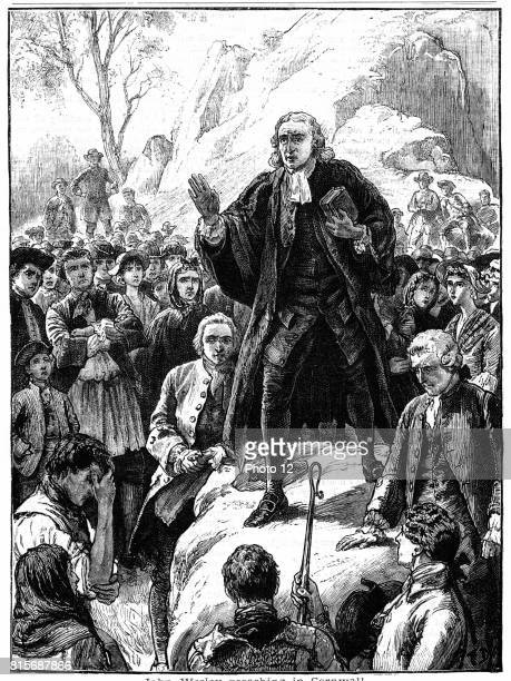 John Wesley English nonconformist preacher Founder of Methodism Wesley preaching in the open air Cornwall England Woodcut 1888