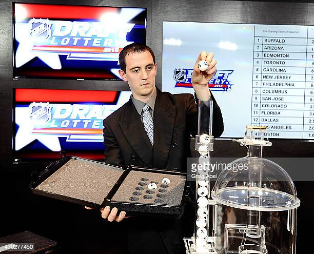 John Wheat loads the lottery balls in the machine at the National Hockey League Draft Lottery on April 18 2015 at the Sportsnet Studios in Toronto...
