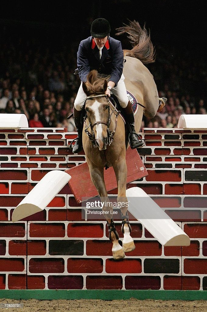 John Whitaker of Great Britain riding St Honores Liquido fails to jump The Accenture Christmas Puissance during the Olympia London International...