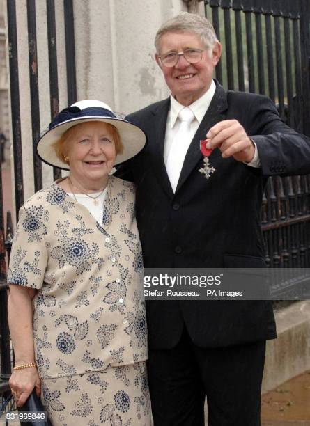 John Whiteley and his wife Joan at Buckingham Palace after he received an MBE from Britain's Queen Elizabeth II