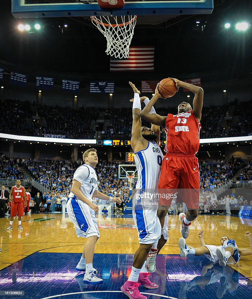 John Wilkins #13 of the Illinois State Redbirds shoots over Gregory Echenique #00 of the Creighton Bluejays during their game at the CenturyLink Center on February 9, 2013 in Omaha, Nebraska.