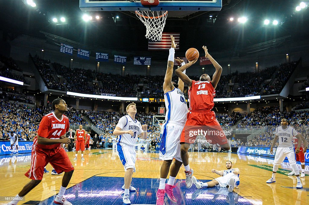 John Wilkins #13 of the Illinois State Redbirds tries to shoot around <a gi-track='captionPersonalityLinkClicked' href=/galleries/search?phrase=Gregory+Echenique&family=editorial&specificpeople=5648736 ng-click='$event.stopPropagation()'>Gregory Echenique</a> #00 of the Creighton Bluejays during their game at the CenturyLink Center on February 9, 2013 in Omaha, Nebraska.