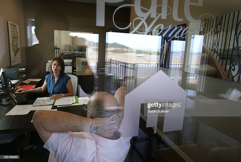 John Willams (R) looks on as Pulte Homes sales associate Jennifer Grantham helps him price a new home at the Pulte Homes Fireside at Norterra-Skyline housing development on March 5, 2013 in Phoenix, Arizona. In 2008, Phoenix, Arizona was at the forefront of the U.S. housing crisis with home prices falling 55 percent between 2005 and 2011 leaving many developers to abandon development projects. Phoenix is now undergoing a housing boom as sale prices have surged 22.9 percent, the highest price increase in the nation, and homebuilders are scrambling to buy up land.
