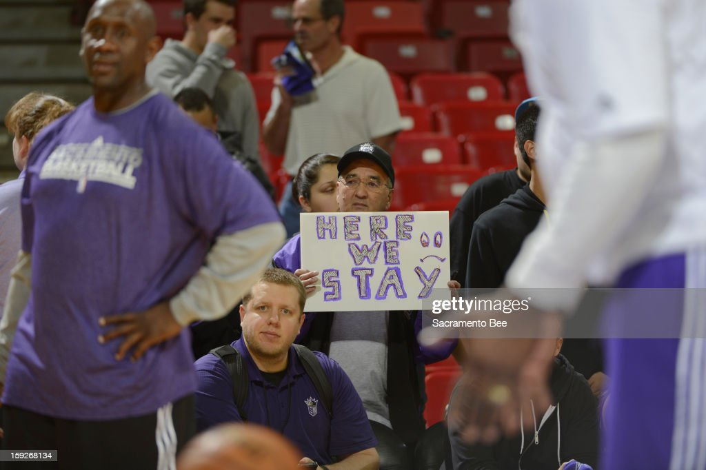 John Willet, a Sacramento Kings season ticket holder since 2002, holds a sign in support of keeping the Kings in Sacramento, California, before a game against the Dallas Mavericks on Thursday, January 10, 2013 at Sleep Train Arena in Sacramento, California.