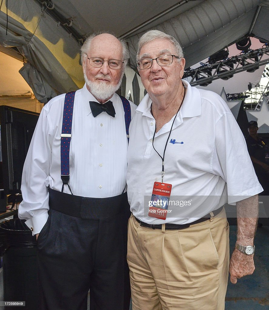 John Williams and Walter Miller pose for a photo during a rehearsal for the 'A Capitol Fourth 2013 Independence Day Concert' on the West Lawn of the US Capitol on July 3, 2013 in Washington, DC.