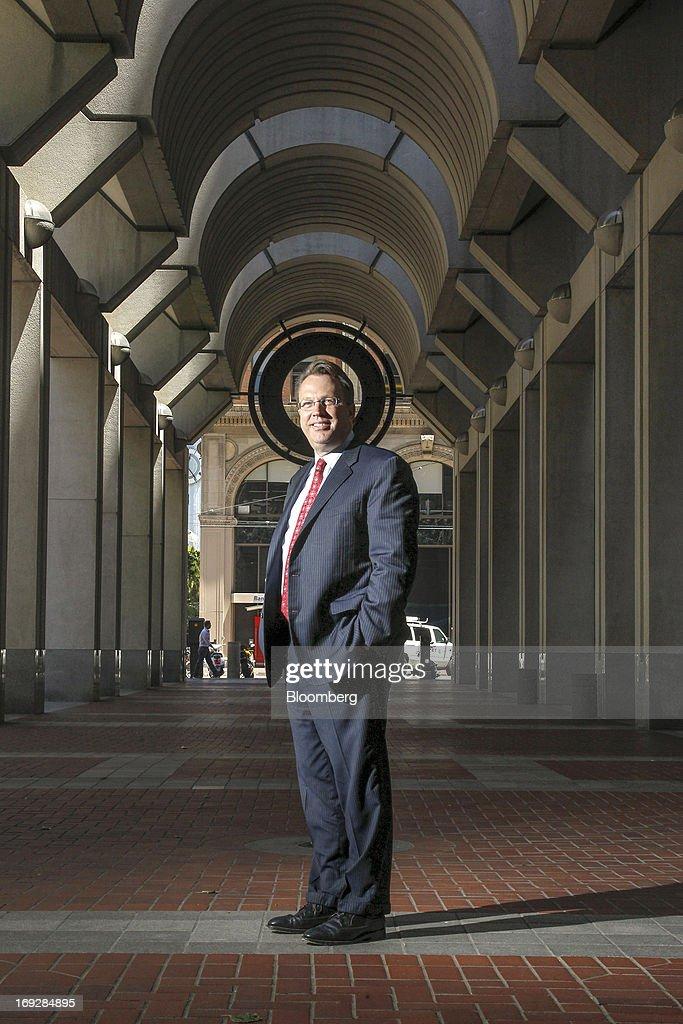 "John Williams, president and chief executive officer of the Federal Reserve Bank of San Francisco, stands for a photograph outside the Federal Reserve Bank in San Francisco, California, U.S., on Wednesday, May 22, 2013. Williams favors a reduction in quantitative easing ""perhaps as early as this summer."" Photographer: Tony Avelar/Bloomberg via Getty Images"