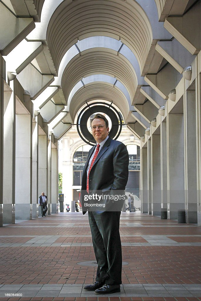 """John Williams, president and chief executive officer of the Federal Reserve Bank of San Francisco, stands for a photograph outside the Federal Reserve Bank in San Francisco, California, U.S., on Wednesday, May 22, 2013. Williams favors a reduction in quantitative easing """"perhaps as early as this summer."""" Photographer: Tony Avelar/Bloomberg via Getty Images"""