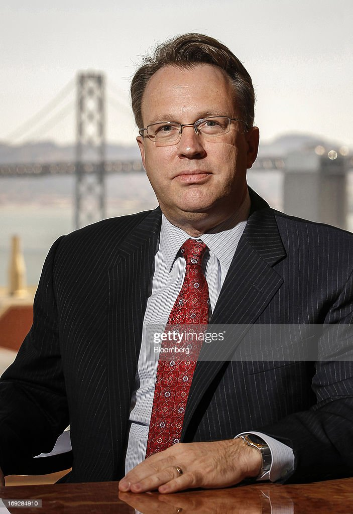 """John Williams, president and chief executive officer of the Federal Reserve Bank of San Francisco, sits for a photograph during a Bloomberg interview in San Francisco, California, U.S., on Wednesday, May 22, 2013. Williams favors a reduction in quantitative easing """"perhaps as early as this summer."""" Photographer: Tony Avelar/Bloomberg via Getty Images"""