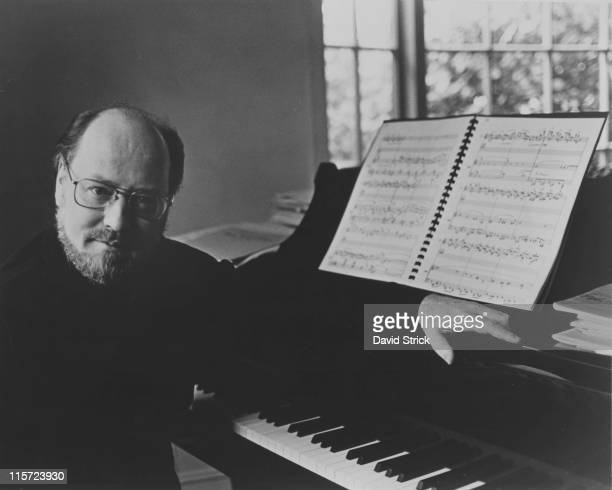 John Williams US composer conductor and pianist poses beside a grand piano at this home in Los Angeles California USA 31 January 1980 Williams is the...