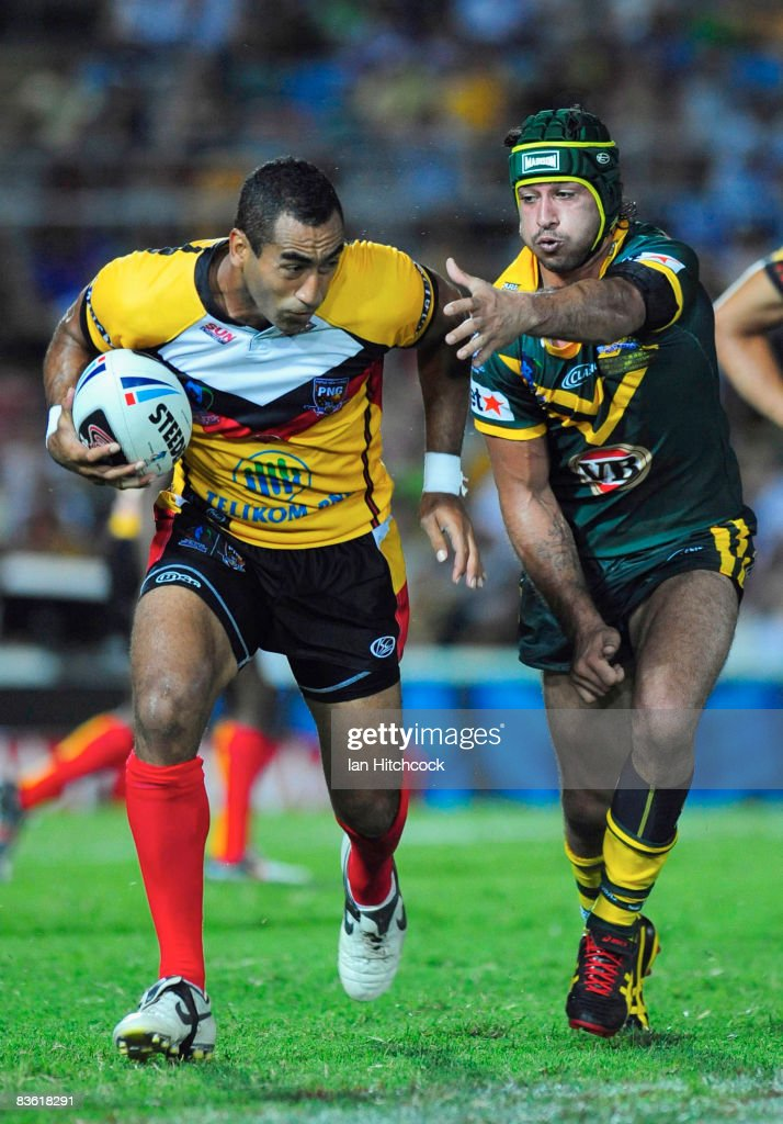 John Wilshere of PNG skips past Johnathan Thurston of Australia during the 2008 Rugby League World Cup Pool 1 match between Papua New Guinea and the...