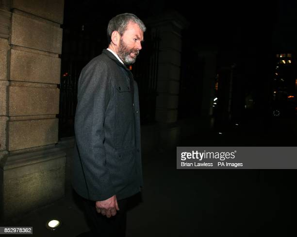 John Wilson leaving the public accounts committee hearing in Leinster House in Dublin