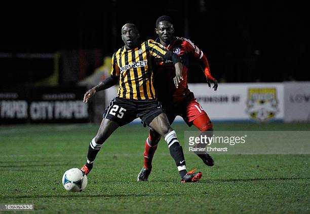 John Wilson of the Charleston Battery and Patrick Nyarko of the Chicago Fire battle for the ball during the first half of a game at Blackbaud Stadium...