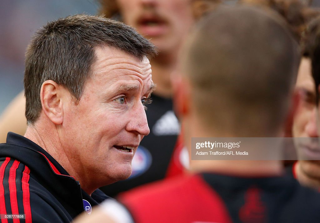 John Worsfold, Senior Coach of the Bombers addresses his players during the 2016 AFL Round 06 match between the Carlton Blues and the Essendon Bombers at the Melbourne Cricket Ground, Melbourne on May 1, 2016.