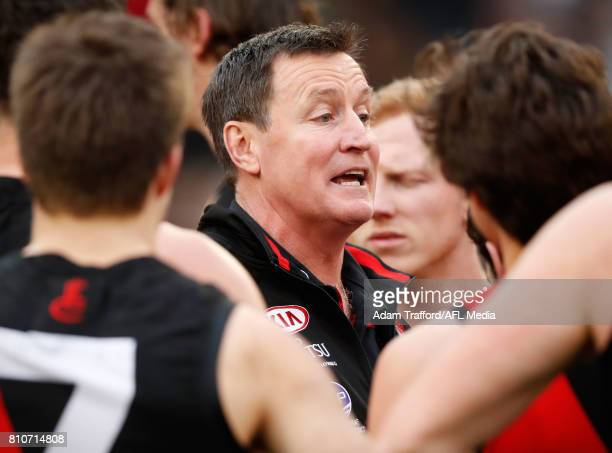 John Worsfold Senior Coach of the Bombers addresses his players during the 2017 AFL round 16 match between the Collingwood Magpies and the Essendon...