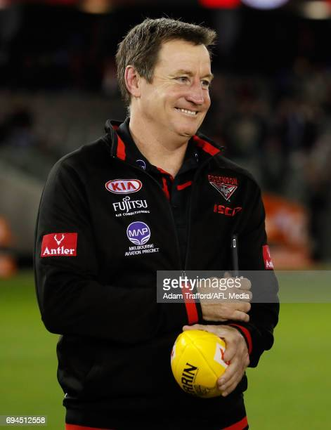 John Worsfold Senior Coach of the Bombers celebrates with his players during the 2017 AFL round 12 match between the Essendon Bombers and the Port...