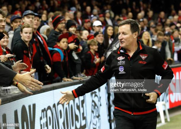 John Worsfold Senior Coach of the Bombers thanks fans during the 2017 AFL round 17 match between the St Kilda Saints and the Essendon Bombers at...