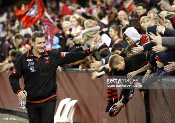 John Worsfold Senior Coach of the Bombers thanks fans during the 2017 AFL round 18 match between the Essendon Bombers and the North Melbourne...