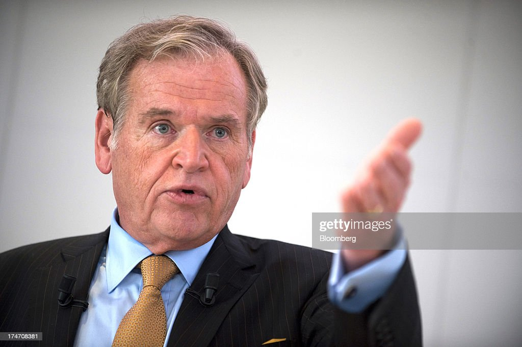 John Wren, chief executive officer of Omnicom Group Inc., gestures during a news conference at the Publicis headquarters in Paris, France, on Sunday, July 28, 2013. Publicis Groupe SA and Omnicom Group Inc. agreed to merge in an all-stock transaction to create the world's largest advertising company with $23 billion in revenue, toppling market leader WPP Plc. Photographer: Balint Porneczi/Bloomberg via Getty Images