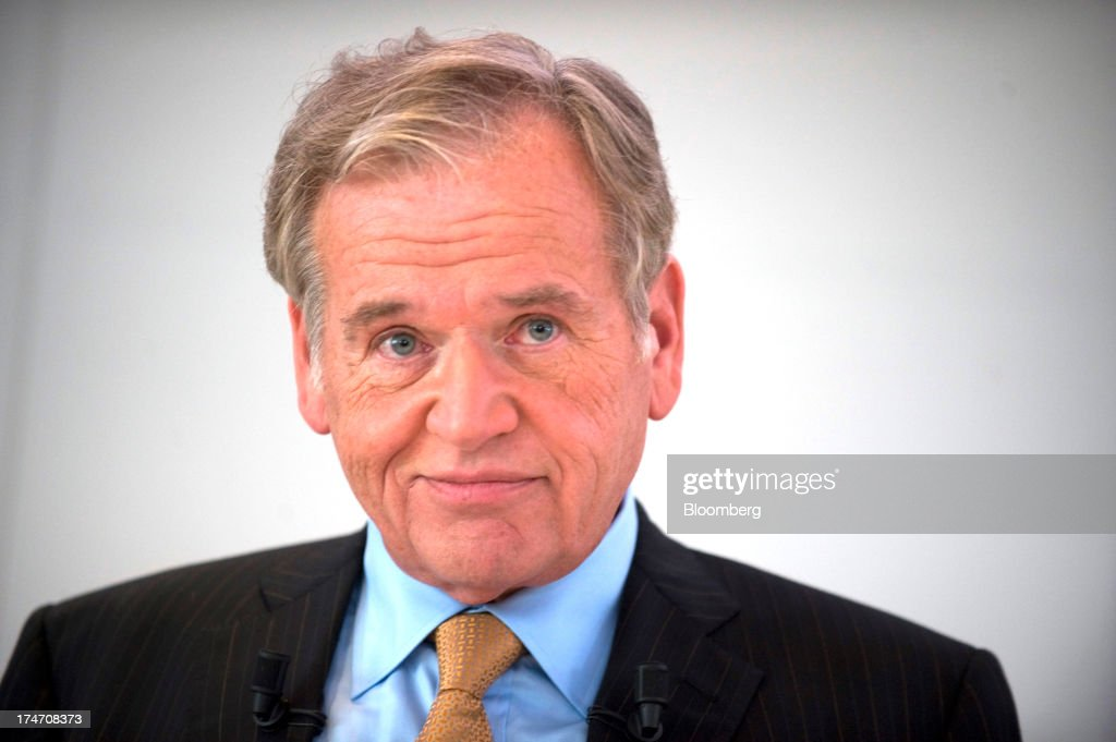 John Wren, chief executive officer of Omnicom Group Inc., pauses during a news conference at the Publicis headquarters in Paris, France, on Sunday, July 28, 2013. Publicis Groupe SA and Omnicom Group Inc. agreed to merge in an all-stock transaction to create the world's largest advertising company with $23 billion in revenue, toppling market leader WPP Plc. Photographer: Balint Porneczi/Bloomberg via Getty Images