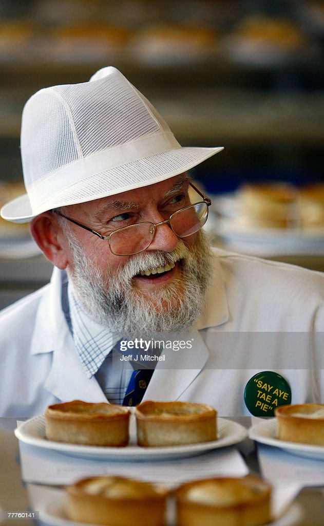 John Young a judge at the World Scotch Pie Championship inspects a pie during judging at Lauder College November 7, 2007 in Dunfermline, Scotland. A total of 70 bakers and butchers will vie for the coveted title of World Scotch Pie Champion.