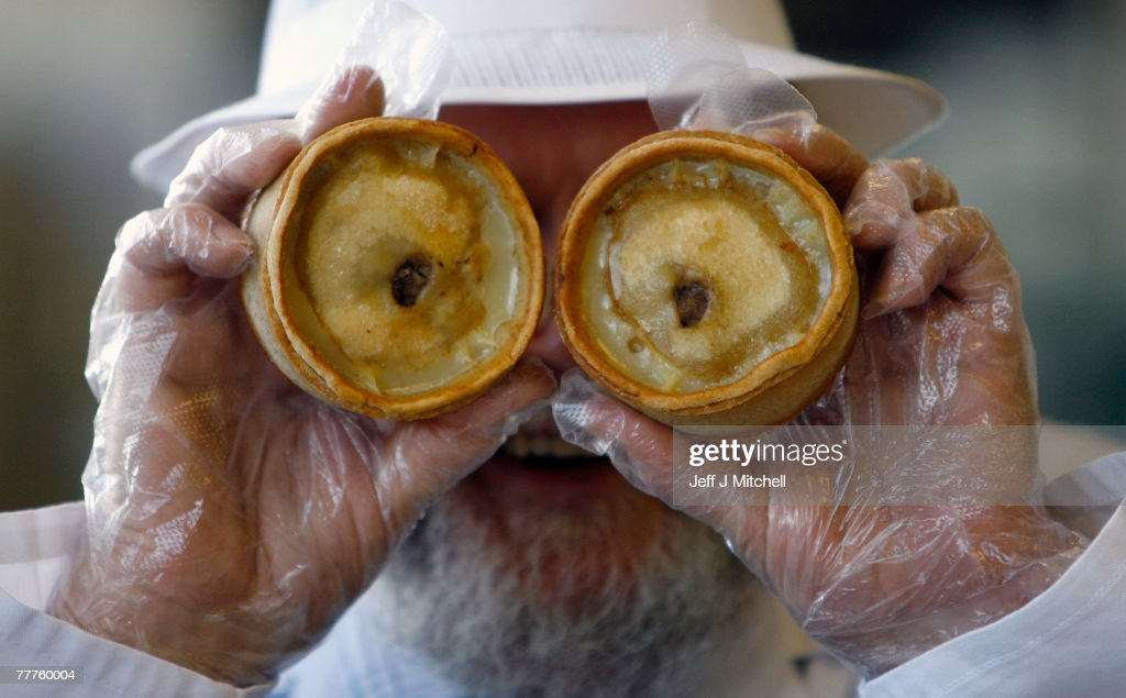 John Young a judge at the World Scotch Pie Championship jokes with pies during judging at Lauder College November 7, 2007 in Dunfermline, Scotland. A total of 70 bakers and butchers will vie for the coveted title of World Scotch Pie Champion.