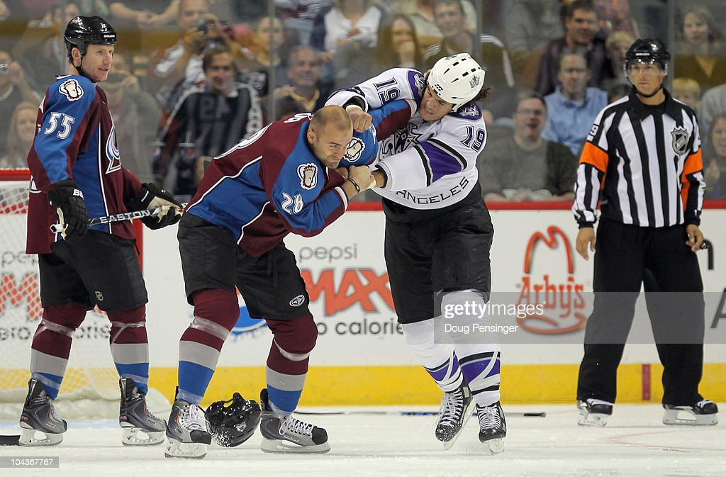 John Zeiler #13 of the Los Angeles Kings and David Koci #28 of the Colorado Avalanche engage in a fight as <a gi-track='captionPersonalityLinkClicked' href=/galleries/search?phrase=Cody+McLeod&family=editorial&specificpeople=2242985 ng-click='$event.stopPropagation()'>Cody McLeod</a> #55 of the Avalanche and referee Ghislain Hebert watch during preseason NHL action at the Pepsi Center on September 22, 2010 in Denver, Colorado.