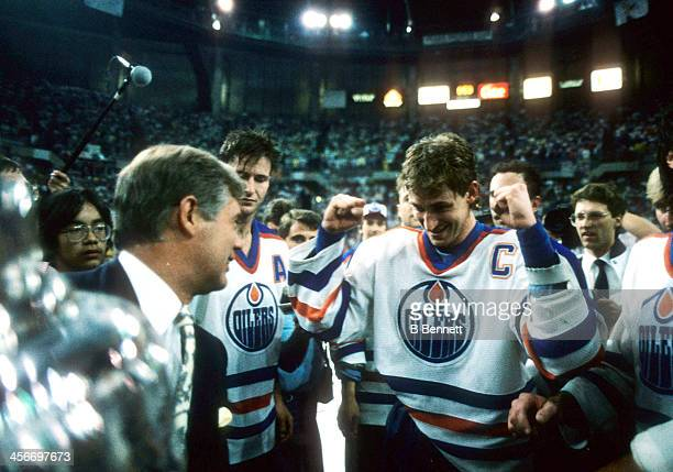 John Ziegler presents Wayne Gretzky of the Edmonton Oilers the Stanley Cup after the Oilers defeated the Philadelphia Flyers in Game 7 of the 1987...