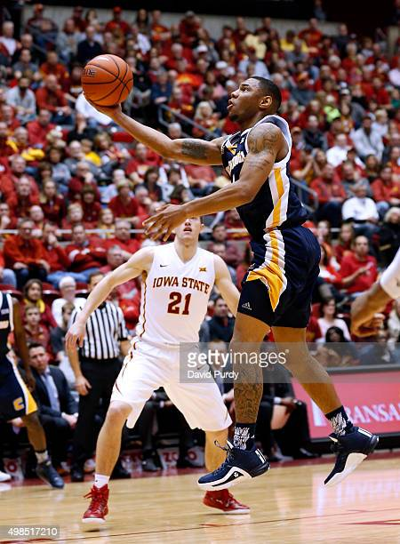Johnathan BurroughsCook of the Chattanooga Mocs lays up a shot as Matt Thomas of the Iowa State Cyclones defends in the second half of play at Hilton...