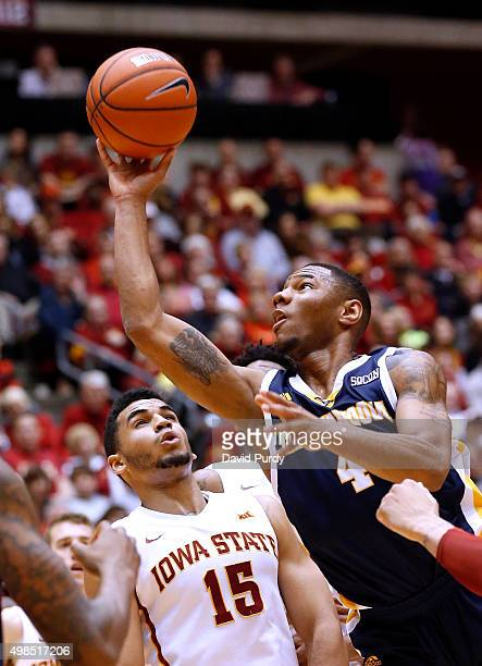 Johnathan BurroughsCook of the Chattanooga Mocs lays up a shot over Nazareth MitrouLong of the Iowa State Cyclones in the second half of play at...