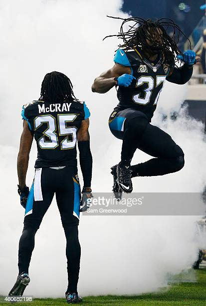 Johnathan Cyprien and Demetrius McCray of the Jacksonville Jaguars take the field for their game against the Tennessee Titans at EverBank Field on...