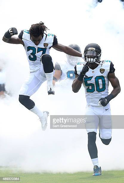 Johnathan Cyprien of the Jacksonville Jaguars and Telvin Smith enter the stadium before the game against the Carolina Panthers at EverBank Field on...
