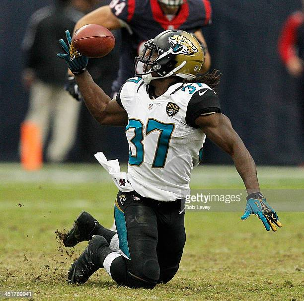 Johnathan Cyprien of the Jacksonville Jaguars can't gain control of the ball for an interception against the Houston Texans at Reliant Stadium on...