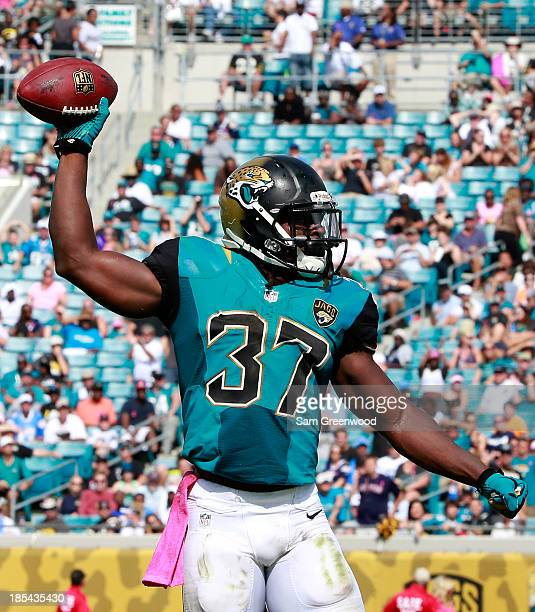 Johnathan Cyprien of the Jacksonville Jaguars celebrates a fumble recovery during the game against the San Diego Chargers at EverBank Field on...