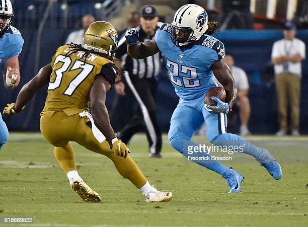 Johnathan Cyprien of the Jacksonville Jaguars pursues running back Derrick Henry of the Tennessee Titans during the first half at Nissan Stadium on...