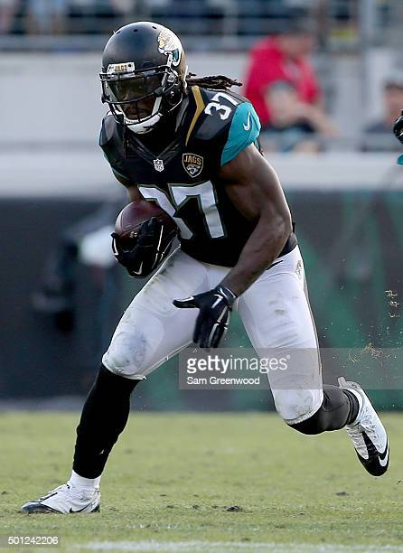 Johnathan Cyprien of the Jacksonville Jaguars runs for yardage after making an interception during the game against the Indianapolis Colts at...