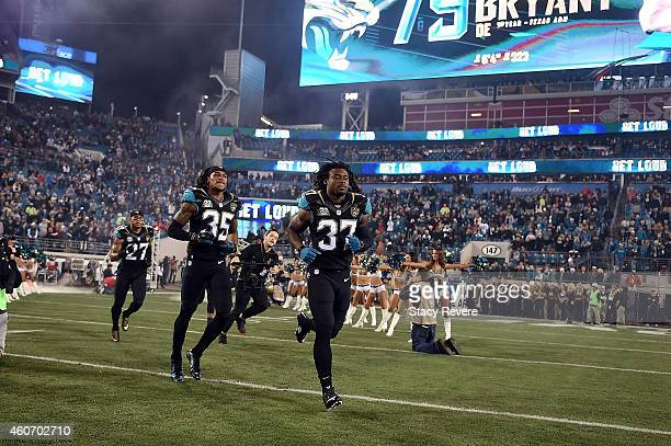 Johnathan Cyprien takes the field with Dwayne Gratz and Demetrius McCray of the Jacksonville Jaguars prior to a game against the Tennessee Titans at...