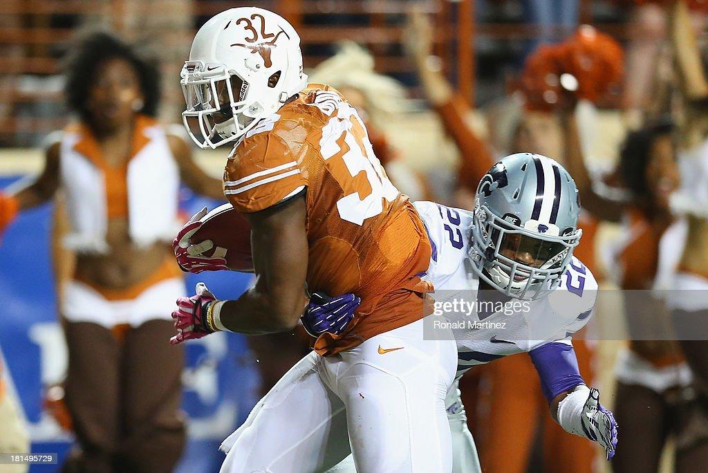 Johnathan Gray #32 of the Texas Longhorns runs for a touchdown past Dante Barnett #22 of the Kansas State Wildcats at Darrell K Royal-Texas Memorial Stadium on September 21, 2013 in Austin, Texas.