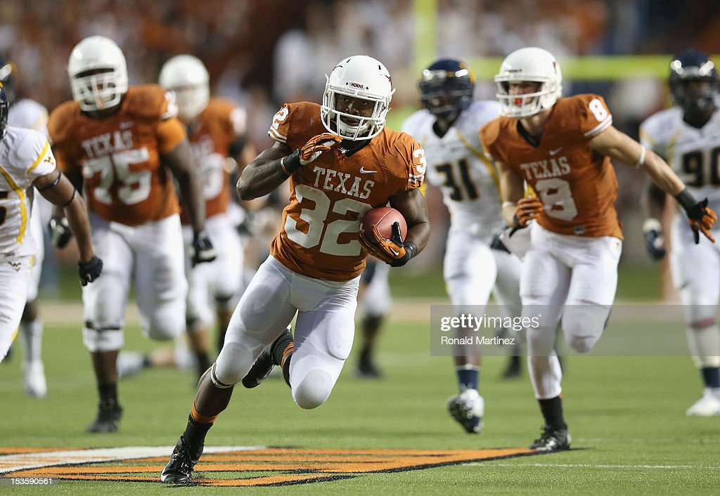 Johnathan Gray #32 of the Texas Longhorns runs the ball against the West Virginia Mountaineers at Darrell K Royal-Texas Memorial Stadium on October 6, 2012 in Austin, Texas.