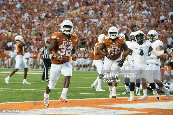 Johnathan Gray of the Texas Longhorns rushes for a 1yard touchdown against the Rice Owls during the first quarter on September 12 2015 at Darrell K...