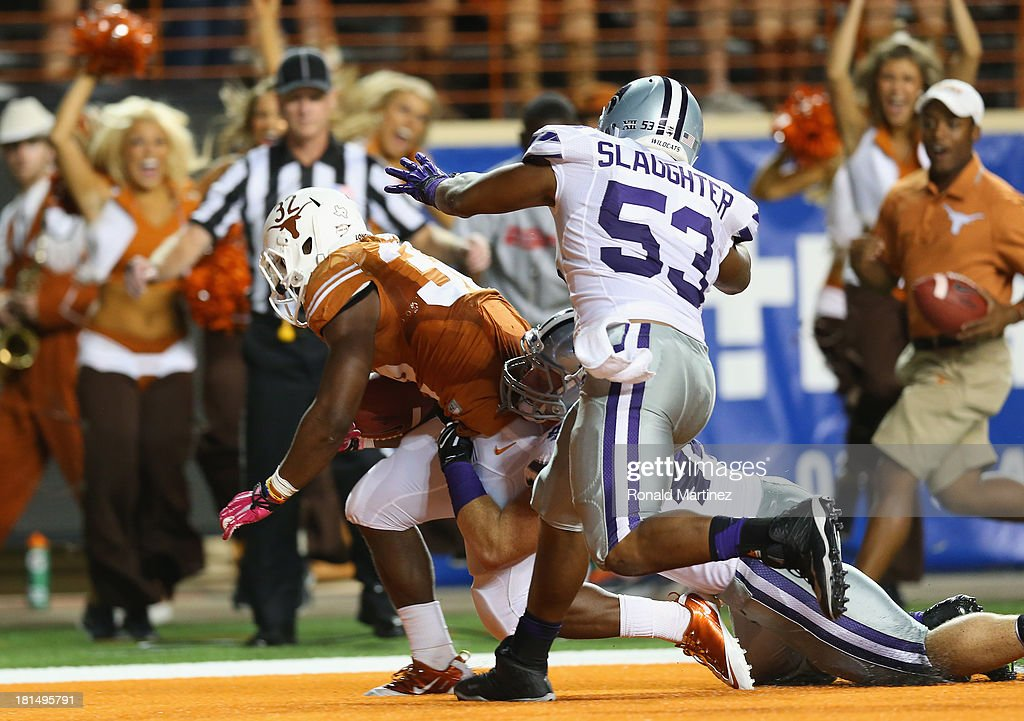 Johnathan Gray #32 of the Texas Longhorns scores a touchdown against Ryan Mueller #44 and Blake Slaughter #53 of the Kansas State Wildcats at Darrell K Royal-Texas Memorial Stadium on September 21, 2013 in Austin, Texas.