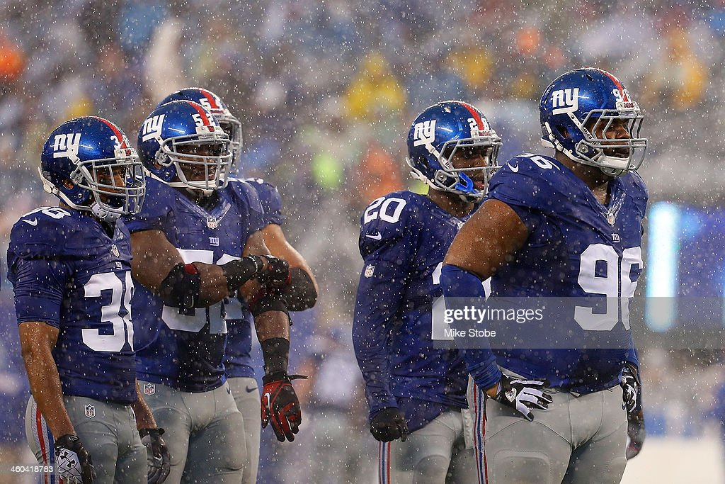 Johnathan Hankins #96, Prince Amukamara #20, Trumaine McBride #38 and Jon Beason #52 of the New York Giants in action against the Washington Redskins at MetLife Stadium on December 29, 2013 in East Rutherford, New Jersey. Giants defeated the Redskins 20-6.